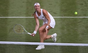 Kiki Bertens dinks a shot over the net on her way to victory over Mandy Minella.