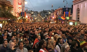 People gather in the Castro District for a vigil for the victims of the Orlando shooting.