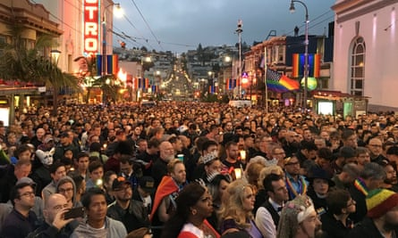A vigil for Orlando victims in San Francisco's Castro district. The nation's largest LGBT pride event will see a 'significant police presence' as a result of the attack.