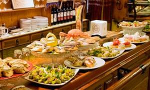 A counter laden with pintxo and salad dishes at Bar Txepetxa, San Sebastian, Spain.