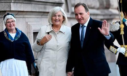 Prime Minister Stefan Löfven and his wife Ulla arrive at the Swedish Parliament Riksdagen on September 25