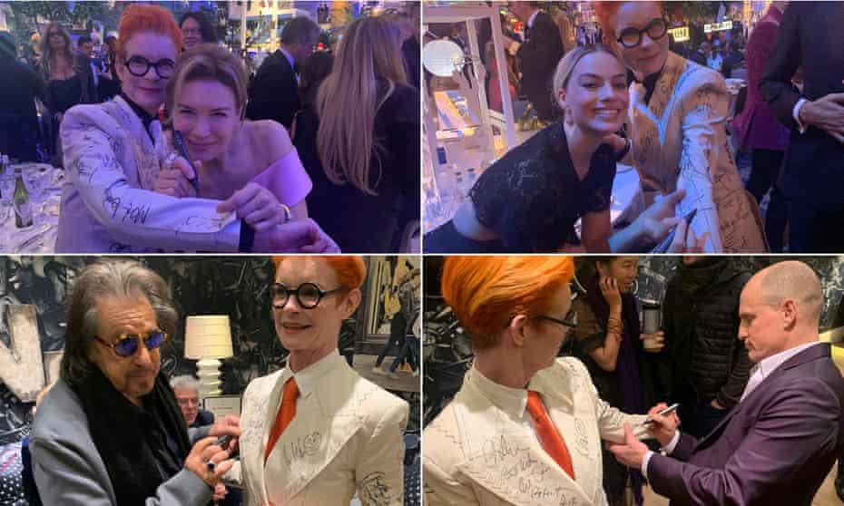 Celebrities sign Sandy Powell's suit.