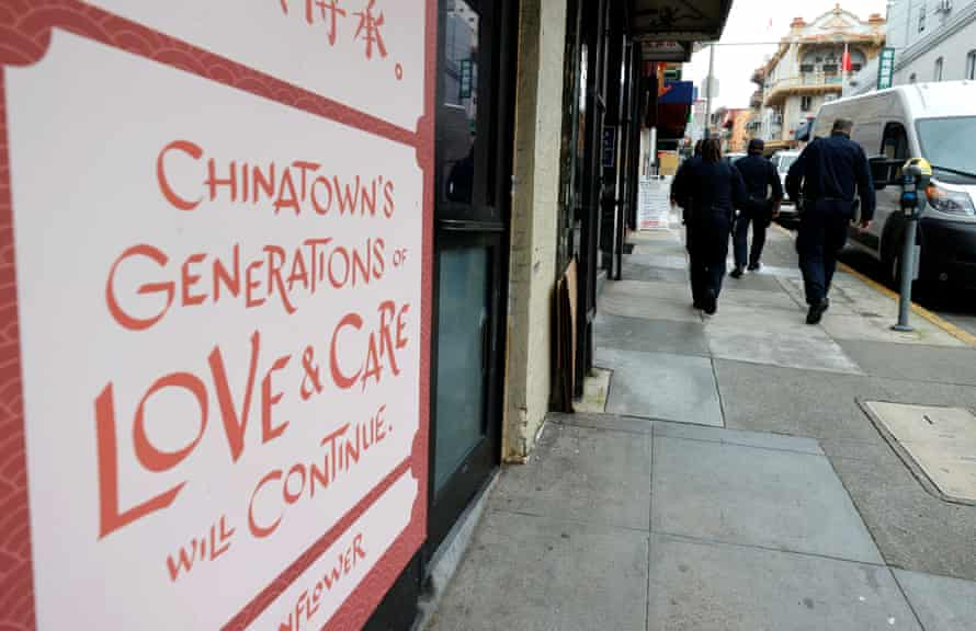 officers in chinatown near sign that says Chinatown's generations of love and care will continue