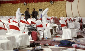 Afghan security forces investigate a suicide bomb attack on a crowd of religious scholars marking the birthday of the prophet Muhammad in Kabul, Afghanistan.