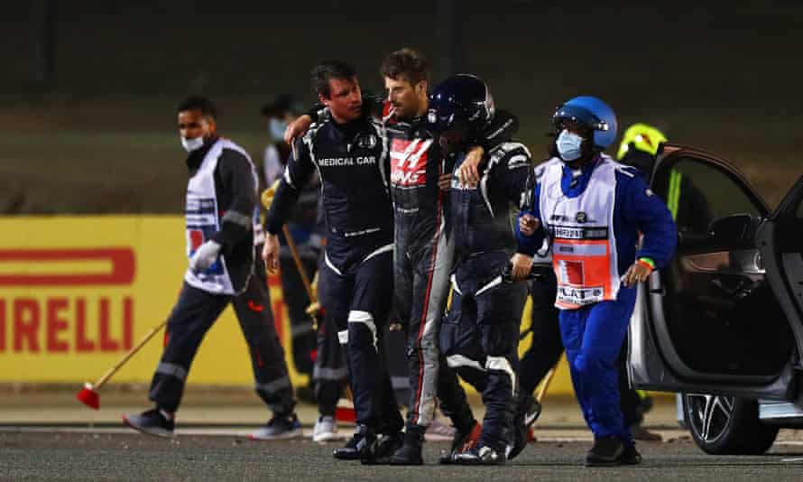 Romain Grosjean escaped with burns to his hands after his Haas car erupted in flames at the Bahrain Grand Prix on Sunday.