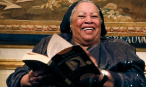 Toni Morrison poses with a copy of her 1977 novel Song of Solomon.