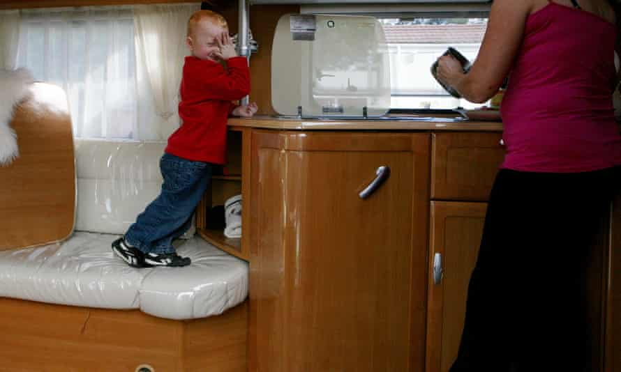 A child in a caravan, on a Traveller site in England.