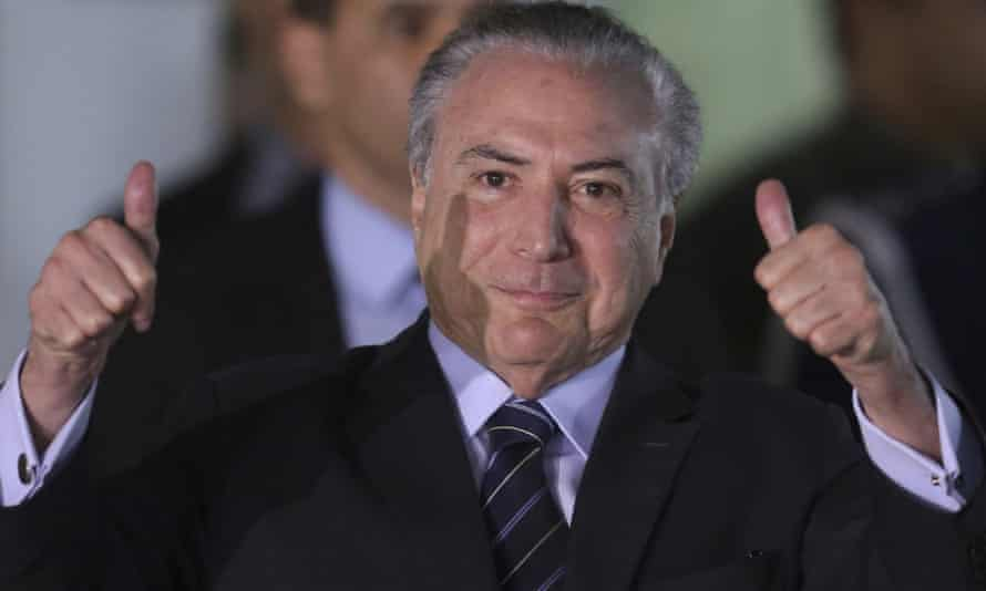 Brazil's president, Michel Temer, gives the thumbs up as he leaves hospital before the key vote on whether he should be tried for corruption.