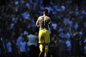 Manchester City's goalkeeper and 'Man of the Match' Ederson Moraes shows off his body art.