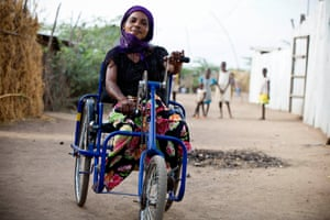 Deborah Mmonga, from the Democratic Republic of the Congo, on her mobility tricycle