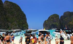 Tour boats block the view of Thailand's Maya Bay.