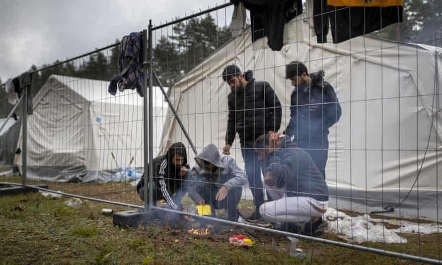 Migrants preparing food last week at a newly built refugee camp in the Rudninkai military training ground, about 23 miles south of Vilnius in Lithuania.