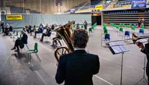 Danes wait to be vaccinated against Covid-19 while the Aalborg Symphony Orchestra plays at the vaccination site in Arena Nord in Frederikshavn, Jutland, Denmark.