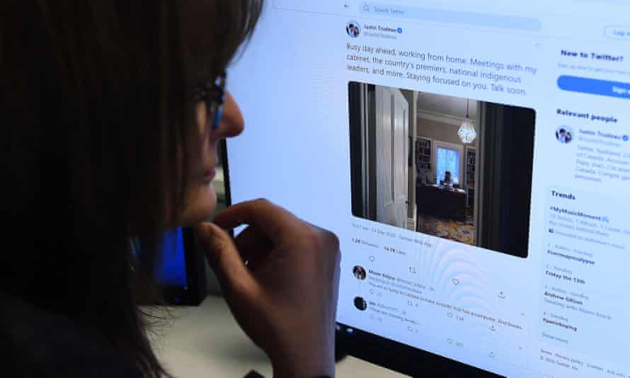 Woman looking at a Twitter feed of Canadian PM