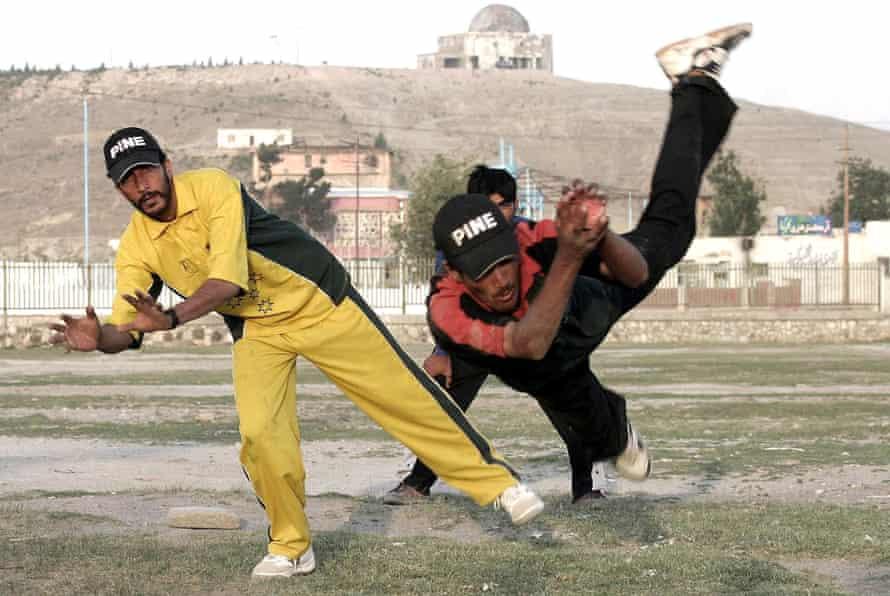 Afghan boys play cricket at Chaman-i-Hazoori in 2004.
