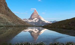 The Matterhorn reflected in Riffelsee, an alpine lake, Zermatt, Swiss Alps.