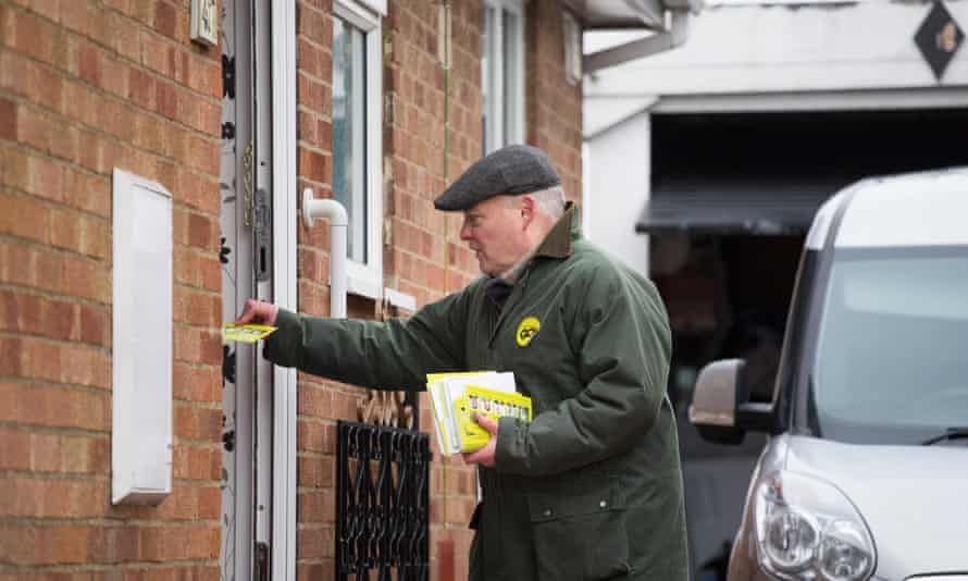 Paul Marks, a campaigner with Grassroots Out, dropping leaflets in Rothwell, Northamptonshire.