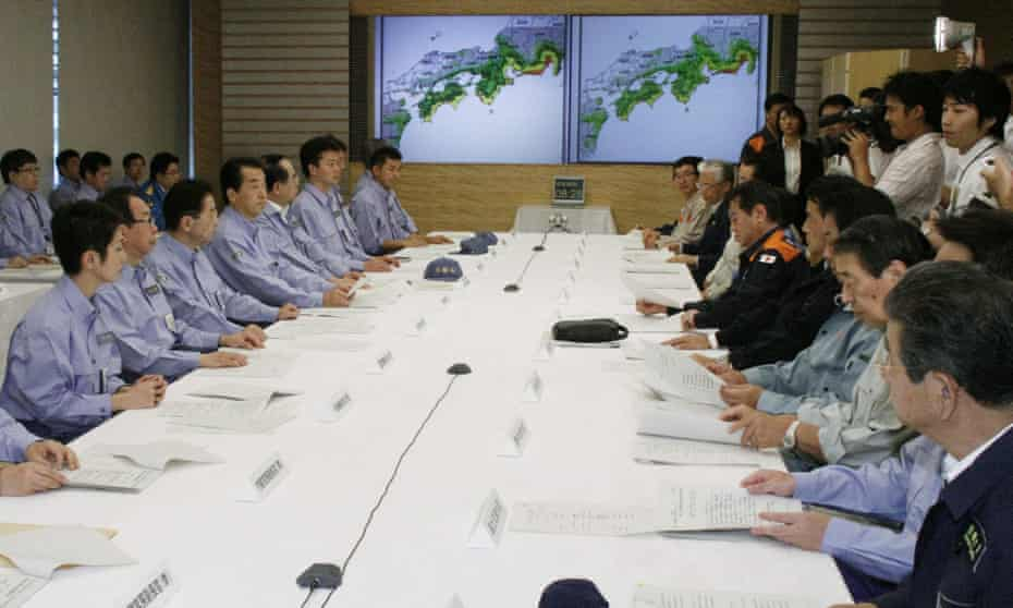 Cabinet ministers hold a meeting in Tokyo as part of a nationwide disaster drill on the annual disaster awareness day, 1 September, the 1923 Great Kanto earthquake anniversary.