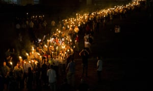 White Supremacists March with Torches in CharlottesvilleCHARLOTTESVILLE, USA - AUGUST 11: Neo Nazis, Alt-Right, and White Supremacists march through the University of Virginia Campus with torches in Charlottesville, Va., USA on August 11, 2017. (Photo by Samuel Corum/Anadolu Agency/Getty Images)