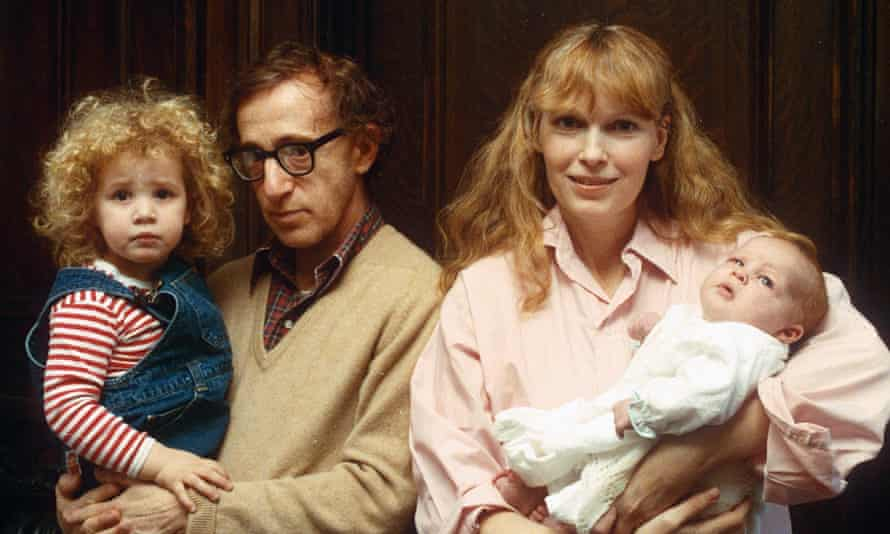 As an infant with, from left, sister Dylan, father Woody Allen and mother Mia Farrow.