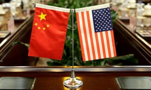 FILE PHOTO: Flags of U.S. and China are placed for a meeting in BeijingFILE PHOTO: Flags of U.S. and China are placed for a meeting between Secretary of Agriculture Sonny Perdue and China's Minister of Agriculture Han Changfu at the Ministry of Agriculture in Beijing, China June 30, 2017. REUTERS/Jason Lee/File Photo
