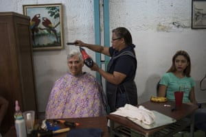 Caracas, VenezuelaVolunteer hairstylist Ingrid Pulido gives a free cut to Marlene Cordoba as part of a Mother's Day block party in Caracas, Venezuela. Although Mother's Day was officially celebrated the previous weekend, people in the Petare area organised neighbourhood activities to celebrate the mothers of their community