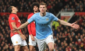 Edin Dzeko celebrates after scoring for Manchester City against Manchester United. 'I loved the feeling of the derby, that pressure, the atmosphere,' he says.