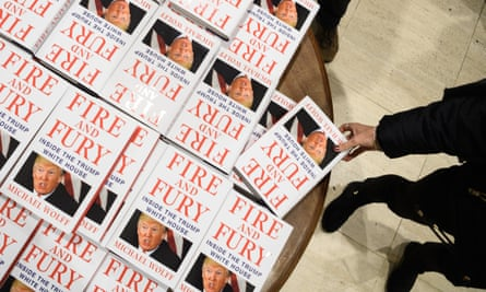 Customers purchase copies of one of the first UK consignments of Fire and Fury, Michael Wolff's book on President Trump's presidency, at Waterstones Piccadilly in January 2018.