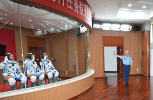 Xu Qiliang, a member of the Political Bureau of the Communist Party of China Central Committee and vice chairman of the Central Military Commission, meets astronauts Nie Haisheng, Liu Boming and Tang Hongbo of the Shenzhou-12 mission before the launch at the Jiuquan satellite launch centre in north-west China