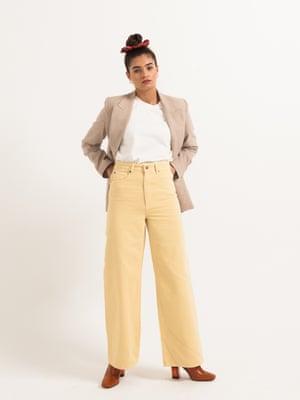 model wears scarf-print scrunchie, £16, by Ganni, from matchesfashion.com. Blazer, £99.99, mango.com. High- waisted jeans, £34.99, hm.com. Boots, £58, office.co.uk.