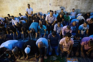 Palestinian worshippers pray in a lane in Jerusalem's old city
