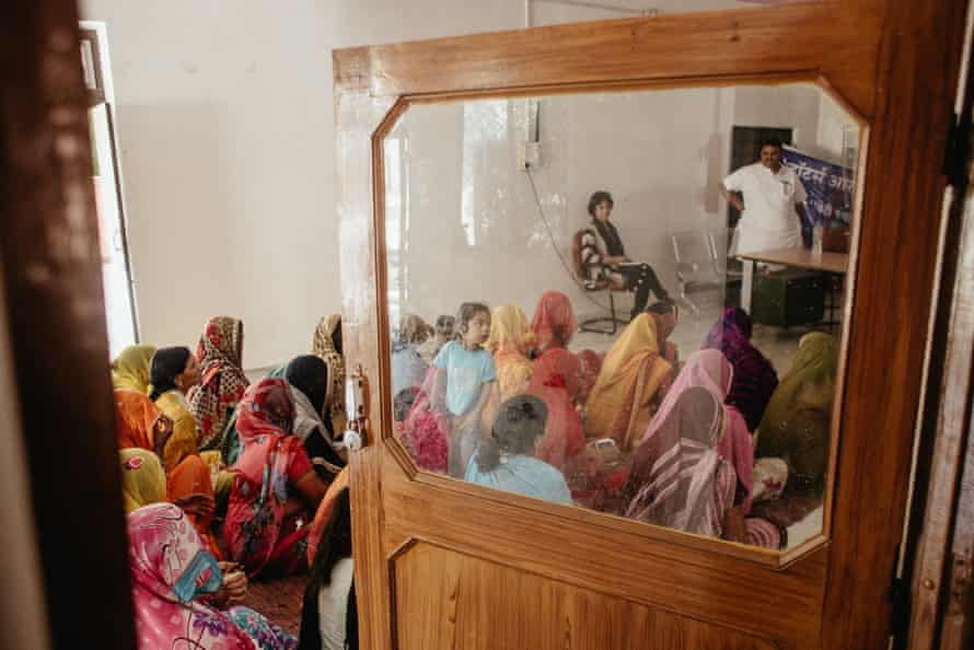 Women participate in a workshop in Piplantri's communal centre