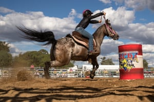 Mudgee, Australia: A competitor steers her mount around one of the markers in the barrel race of the rodeo competition at the 2019 Mudgee Show