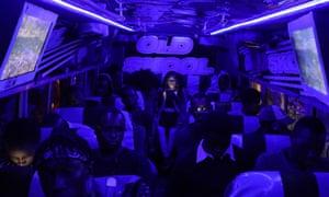 Passengers sit inside a matatu at night