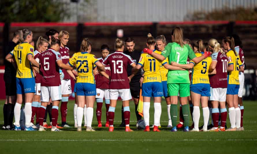 West Ham and Birmingham players link arms before their WSL match on Sunday.