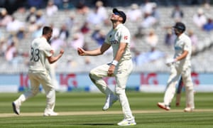 James Anderson of England celebrates taking the catch of Mitchell Santner of New Zealand off the bowling of Mark Wood who is celebrating in the background.