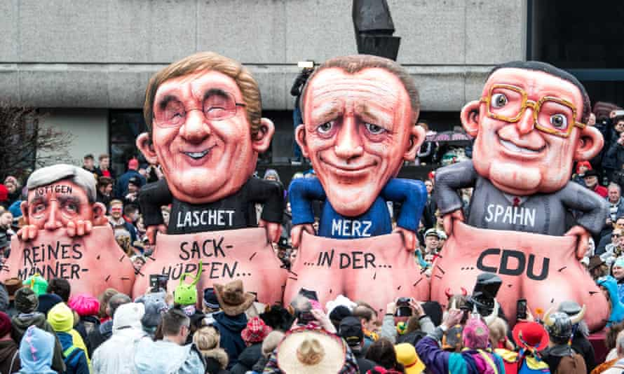 A carnival float in Dusseldorf with models of Norbert Röttgen, Armin Laschet, Friedrich Merz and Jens Spahn, with a message reading 'sack race for men only in the CDU'.