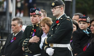 Kathy Cirillo, the wife of Cpl. Nathan Cirillo Laureen Cirillo, mourns as her son Marcus Cirillo (2nd R), looks on during Nathan Cirillo's funeral at the Christ's Church Cathedral.