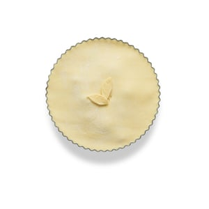 Line a pie dish with rolled pastry, fill, top with a pastry lid and seal the edges with egg wash.