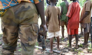 Children gather near Bambari in Central African Republic during a military training session held in May 2015