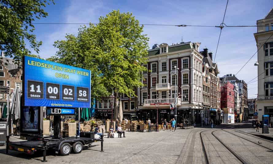 A sign in Amsterdam's Leidseplein counting the days until bar terraces are allowed to reopen.