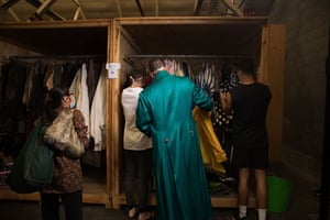 Shoppers browse racks of costumes at the Opera Australia sale.