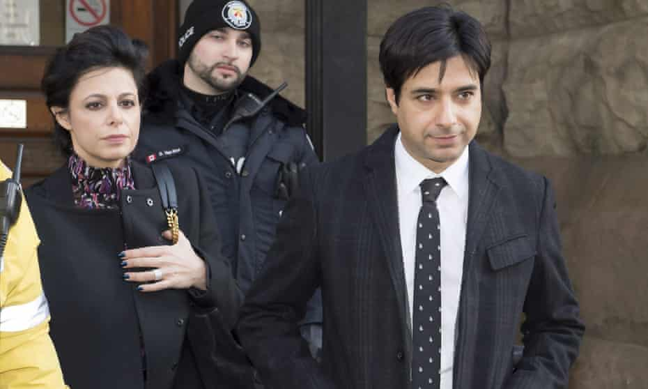 Jian Ghomeshi leaves a Toronto courthouse with his lawyer Marie Henein after the second day of his sexual assault trial on Tuesday Feb. 2, 2016, in Toronto