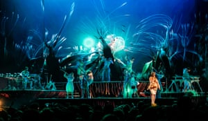 New world … Björk and band with the show's spectacular backdrop.