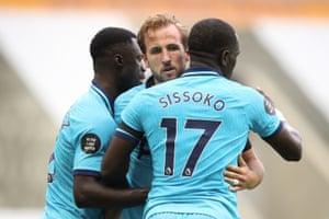 Kane celebrates scoring Tottenham's third.