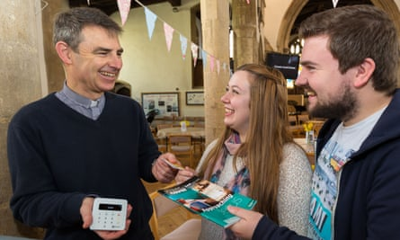 Martyn Taylor, the rector of St George's Church in Stamford, Lincolnshire, takes a contactless payment