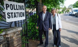Sir Vince Cable, the Lib Dem leader, and his wife Rachel Smith arriving at a polling station to vote.
