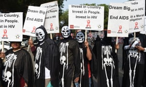 People Living with HIV AIDS (PLHA) carry placards during a protest demanding the revival of focus on India's AIDS programme which has been on the decline in the past few years, in New Delhi on December 1, 2015, World AIDS Day. AFP PHOTO / SAJJAD HUSSAINSAJJAD HUSSAIN/AFP/Getty Images