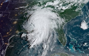 A satellite image shows Hurricane Ida making landfall on the Louisiana coast.