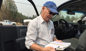 The Lake county supervisor Jim Steele looks at a list of addresses to check for fire damage.